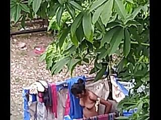 Desi teen bathing is public
