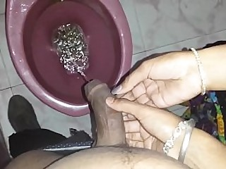 Bitch holding my dick while I piss